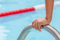 Start swimming race concept with closeup the hand grab on ladder Stock Images