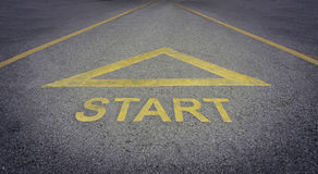 Start text with arrow direct on a rough road Stock Images