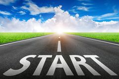 Start text on long road. A long straight road and blue sky royalty free stock photo