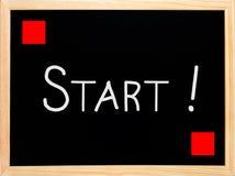 Start text written on blackboard, chalkboard Stock Images