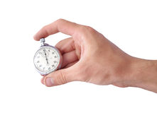 Start time. Hand and stopwatch isolated on white background Royalty Free Stock Images