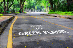 Start to green planet word on the road at the park Royalty Free Stock Photo