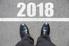Start to new year 2018. With top view of business man walking on the road Stock Photo