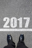 Start to new year 2017. Top view of business man walking on the road Stock Images