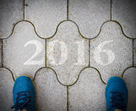 Start to new year 2016 - top view of  man walking on the road Royalty Free Stock Images