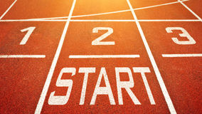 Start To Run. Concept with numbers and word on running track Royalty Free Stock Image
