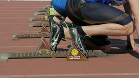 Start to sprint 100 meters men athletes, closeup feet runners stock video