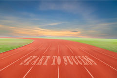 Start to Success written on running track written on Running tra Royalty Free Stock Image
