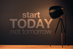 Start today not tomorrow. Motivational quote on office wall stock photo