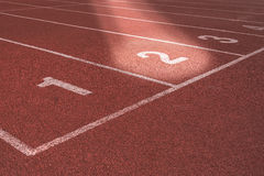 Start track lanes 1 2 3 of a red racing track Stock Images