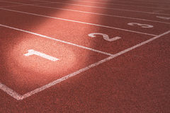 Start track lanes 1 2 3 of a red racing track Royalty Free Stock Photo