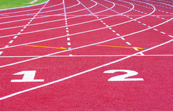 Start track. line on a red running track Royalty Free Stock Images