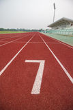 Start track number 7 on red running track. Royalty Free Stock Photo
