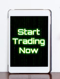 Start Trading now Stock concept text on tablet Royalty Free Stock Photography