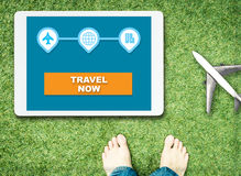 Start travel now on tablet with feet and plane Royalty Free Stock Photography