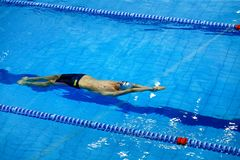 Start under water athlete swimmer swimming backstroke. Chelyabinsk, Russia - March 13, 2018: start under water athlete swimmer swimming backstroke during Royalty Free Stock Photo