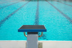 Start up block with lane of water in  blue swimming pool Royalty Free Stock Images