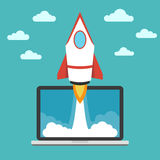 Start up business concept. Spaceship and laptop Stock Images