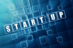 Start-up business concept. Start-up text in 3d blue glass cubes with white letters, business concept Stock Image