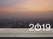 2019 start up business flat icon on table over blur of cityscape on warm light sundown, Happy new year concept stock image