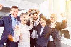 Start-up business party celebration. With winner cup in office Stock Image