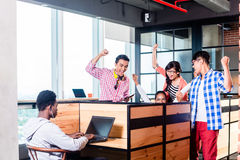Start-up business people in cubicles. Working together having success Royalty Free Stock Images
