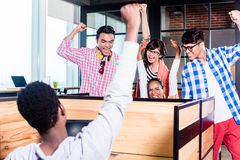 Start-up business people in cubicles Royalty Free Stock Images