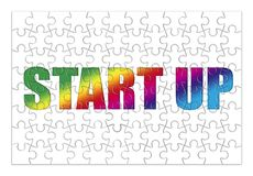 Start Up colored concept image in puzzle shape Royalty Free Stock Photo