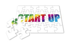 Start Up colored concept image in puzzle shape Stock Photos