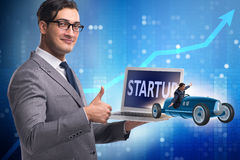 The start-up concept with businessman driving car Royalty Free Stock Image