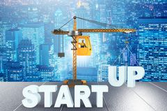 The start-up concept with crane lifting letters. Start-up concept with crane lifting letters Royalty Free Stock Images