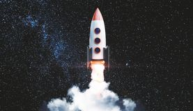 Start up and exploration concept. Creative launching rocket ship on starry night sky background. Start up and exploration concept. 3D Rendering royalty free stock photo