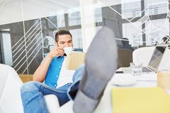 Start-up founder takes coffee break Royalty Free Stock Photo
