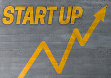 Start up graph concept on cement texture background Royalty Free Stock Images
