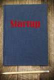 Start-up inscription concept on notebook Royalty Free Stock Images