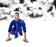 Start up man below black clouds Royalty Free Stock Photos