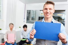 Start-up man holds blank page Royalty Free Stock Photo