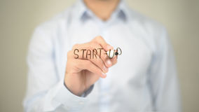 Start Up, Man Writing on Transparent Screen royalty free stock photography