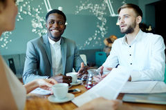 Start-up meeting. Successful employers talking to manager at briefing stock photo