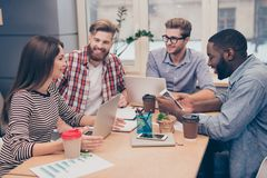Start-up multiethnic entrepreneurs working on their project in c. Oworking atmosphere stock image