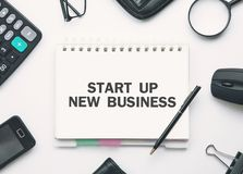Start up new business text in notepad. Business concept royalty free stock images