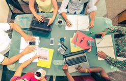 Start up office. Team of young business people at a meeting - Start up conference, group of investors planning a new strategy - Office desk with computers,phones Stock Image