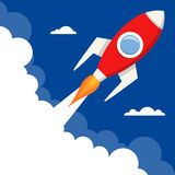 Start Up Rocket Flying with Blank Space. Start up concept: a cartoon red space rocket takes off from a planet to explore the universe, on blue background with Royalty Free Stock Images