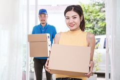 Freelance woman and man which their hands holding box. Start up small business entrepreneur SME or freelance women and men which their hands holding box, online royalty free stock photos