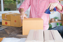 Start up small business owner packing cardboard box at workplace Stock Photography