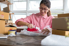 Start up small business owner packing shoes in the box at workpl Stock Photography