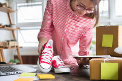 Start up small business owner working with digital tablet at wor Stock Photos