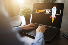 Start up spaceship on device screen. Business and finance concept. royalty free stock image