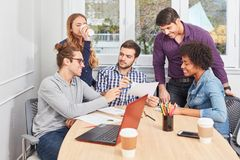 Start-Up Team discusses finances in the meeting Stock Photography