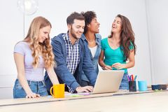 Start-Up Team has fun with a computer training. Young business start-up team is having fun with a computer training on laptop royalty free stock image